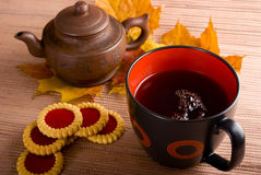 The tea is hot. Cup of hot tea with cakes Stock Images