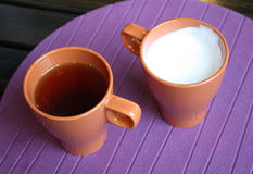 Tea and hot milk cups Royalty Free Stock Image