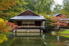 Tea house reflecting in pond in Japanese Garden Stock Photos
