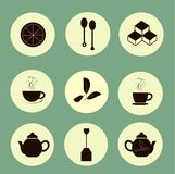 Tea icons black marks on light yellow, pastel green background Stock Photos