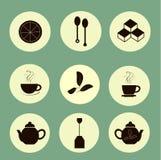 Tea icons black marks on light yellow, pastel green background Stock Photos