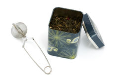 Tea infuser and can Stock Photo