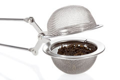 Tea infuser with Green Tea leaves royalty free stock photography