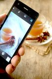 Tea infusion food photography with mobile phone Stock Image