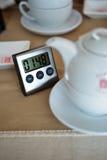 Tea infusion timer. Near tea cup stock photo