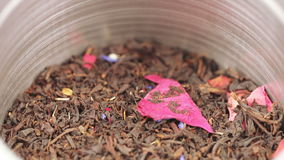 Tea in an iron jar with a lid. Rotating the iron box with tea and transparent lid stock footage