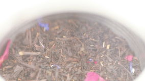 Tea in an iron jar with a lid. Rotating the iron box with tea and transparent lid stock video