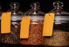 Tea Jars. Tea in glass jars on black background Royalty Free Stock Images