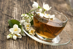 Tea and jasmine Stock Photos