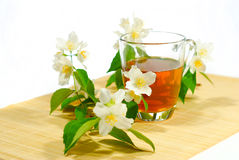 Tea with jasmine flower Royalty Free Stock Images