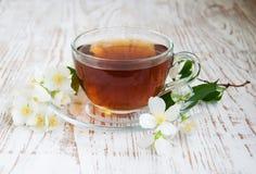Tea and jasmine flowers Stock Photography