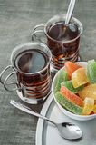 Tea and jelly candies. Royalty Free Stock Image
