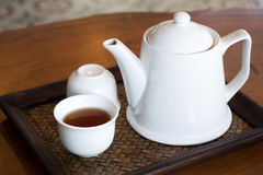 Tea jug on wooden table Stock Photos