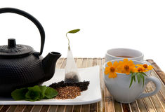Tea Kettle. Cast iron tea kettle and tea cups Royalty Free Stock Photo