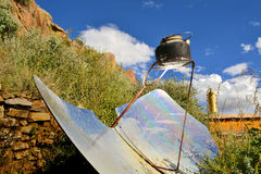 Tea kettle boiling by solar parabolic reflector Stock Photos