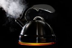 Tea kettle with boiling water Stock Photo