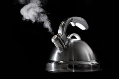 Tea kettle with boiling water Stock Images