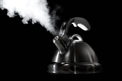 Tea kettle with boiling water Stock Photos