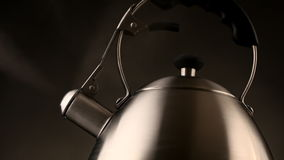 Tea kettle with boiling water stock video