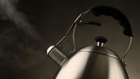 Tea kettle with boiling water stock footage