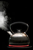 Tea kettle with boiling water on black background Stock Photo