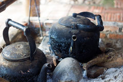 Tea kettle with boiling water on fire wood royalty free stock images