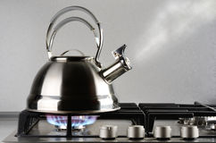 Kettle boiling. Tea kettle with boiling water on gas stove royalty free stock photography