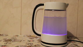 Tea kettle with boiling water. Water boiling in kettle stock footage