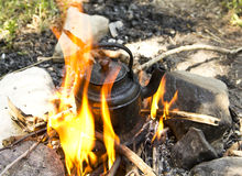 Tea kettle on fire Stock Photography
