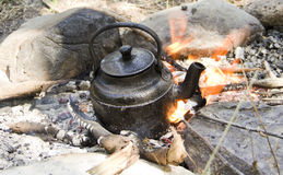 Tea kettle on fire Stock Images