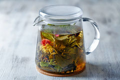 Tea kettle. Glass tea kettle on the wooden table closeup shot Stock Photography