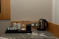 Tea kettle and supplies in hotel room Royalty Free Stock Photos