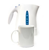 Tea kettle on a white background and a mug Royalty Free Stock Photos