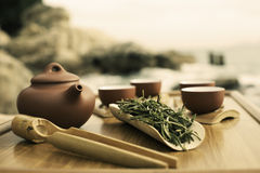 Tea and kung fu tea set. Chinese green tea Huang Shan Mao Feng ready to be prepared by a traditional Kung Fu Cha method. The picture shows a Yixing teapot, cups stock images