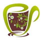 Tea kuper med blommor Arkivbild