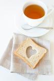 Tea kuper och rostar Fotografering för Bildbyråer