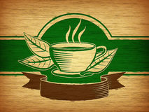Tea label. Wood engraving with a cup, some tea leaves and a banner. Suitable for tea labels and packaging. Digital illustration Stock Image