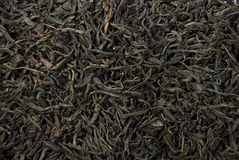 Tea leaves. Dry leaves of black tea are scattered on all shot Royalty Free Stock Image