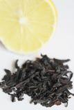 Tea leaves on the background of lemon Stock Photos