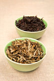 Tea leaves in bowls Stock Photos