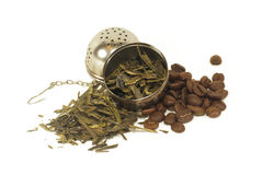 Tea leaves and coffee beans with strainer Stock Photo