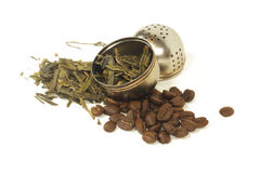 Tea leaves and coffee beans with strainer. Combination of coffee beans and green tea leaves Stock Images