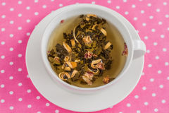 Tea leaves spice in a cup on a pink background Stock Photography