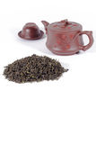 Tea leaves and teapot. Royalty Free Stock Image
