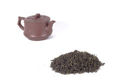 Tea leaves and teapot. Royalty Free Stock Photography