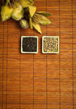 Tea leaves on wooden background Stock Images