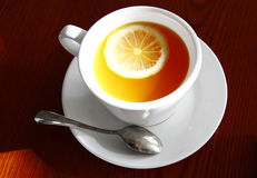 Tea and lemon. Tea cup and lemon on table Stock Image