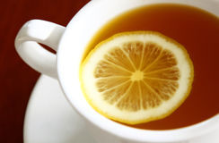 Tea and lemon. Tea cup and lemon on table Stock Photography