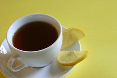 Tea with Lemon. Cup of black tea with lemon Royalty Free Stock Photo