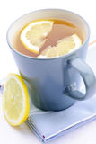 Tea with lemon. Cup of fresh hot tea with lemon slices Stock Images